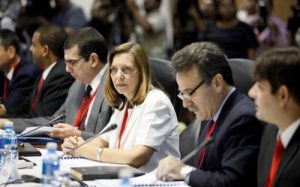 The Cuban delegation, from r., Machin, Vidal, and José Cabañas, head of the Cuban Interests Section in Washington